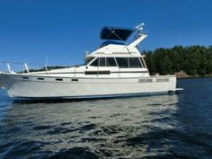 1987 Bayliner 3870 -Beam 13 ft. 5 in. Fiberglass hull. Twin Hino. U.S. Marine 170 H.P. Diesel engines Fuel capacity 304 U.S. gallons. Dual tanks. Water capacity 80 U.S. gallons. Holding tank capacity 30 U.S. gallons. Draft 3 ft. 2 in. 8.0 kilowatt diesel generator. 4 bilge pumps, automatic and manual, Dual staterooms, Dual heads...one with bath and shower, - See more at: http://www.caboats.com/used-boats/8845.htm