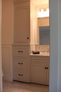 bathroom tall cabinet ideas with tall cabinet serves as a linen closet and extra storage