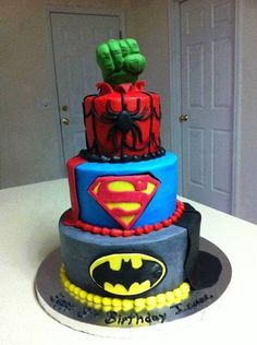 Super Heroes Cake- love the hulk hand coming out the top. Maybe some day for Ezra?