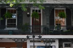 Lambertville NJ - Pretty second story porch with wrought iron and hanging planters Photo @ Brian Cenker