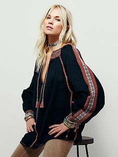 Boho Dreams Top   Ultra-bohemian peasant top featuring beautiful embroidery and V-neckline with tassel tie detailing. Gauzy linen-blend fabrication and effortless, relaxed silhouette make for an easy fit.