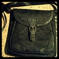 NWT COACH-A-LIKE BLACK CROSSBODY BAG This is not genuine Coach....however, very cute!  It's canvas material with a flap covering a zippered compartment and an additional pocket.  The back has a zippered pocket too.  The strap is adjustable and reminds me of a seatbelt material...strange maybe, but accurate!  Cute bag, never carried, great price. unknown Bags Crossbody Bags