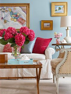 We love the soft blue and pink color palette of this room! More living room designs: http://www.bhg.com/rooms/living-room/room-arranging/living-room-designs/?socsrc=bhgpin061613pinkflowers=4