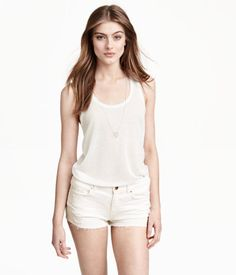 $5.99 - Long, gently flared racerback tank top in jersey.