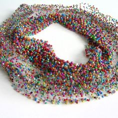 Verena Sieber-Fuchs makes objects that can mainly be worn as jewellery. For this she uses the crochet technique: crocheting with fine wire to which ordinary materials like aluminium foil, paper snippets or onionskins are added as she goes along.