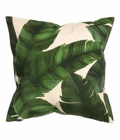 Give your apartment an urban jungle feel with these banana leaf print cushion covers.