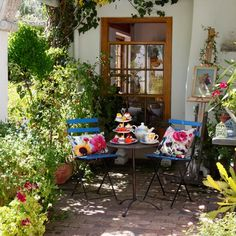 This garden terrace has been brought to life with vibrant cushions and brightly coloured furniture - perfect for afternoon tea in the sunshine