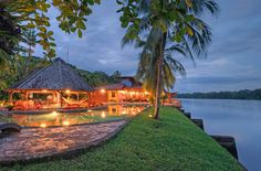 The luxury riverside Tortuguero Lodge after sunset