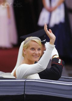 New Crown Princess Mette-Marit of Norway waves to the crowd as the bridal couple leave for the Royal Palace, Oslo; wedding of Crown Prince Haakon of Norway and ms. Mette-Marit Tjessem Høiby, August 25th 2001