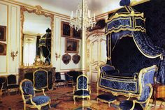 Fit for a king: The blue salon is furnished in Louis XV pieces covered with brocade silk velour. The bed, a lit à la turque, was recreated from period documents. The paintings flanking the fireplace are by Jacques de Lajoue. The Aubusson rug from Versailles belonged to Louis XV.