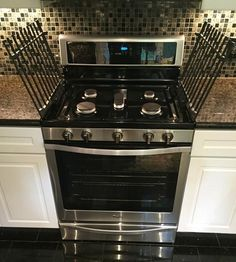 Whirlpool 5.8 cu. ft. Freestanding Gas Range with Center Oval Burner in Stainless Steel WFG745H0FS at The Home Depot - Mobile