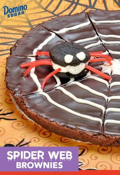 Top this simple brownie with a DIY spider web for a Halloween-themed dessert your kids will scream for.