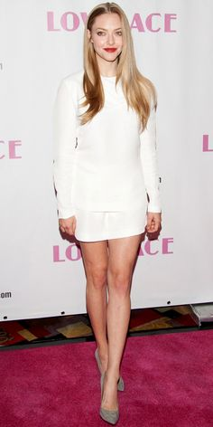 Seyfried promoted Lovelace in a minimalist two-piece white Stella McCartney set: A long-sleeve top and high-waisted shorts. Instead of bold footwear, she stuck with classic dark pumps.