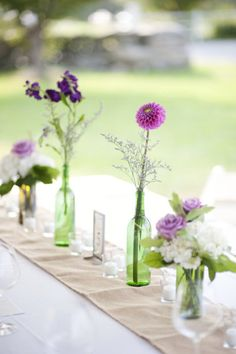 simple centerpiece - burlap runner lined with (reused) wine bottles