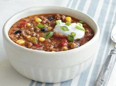 """Beefy Corn and Black Bean Chili  This is a nice easy chili recipe slightly different from what you may be used to.  If you do not have """"chili mix"""" you can add chili powder, cumin, paprika, and a little unsweetened cocoa.  Add salt if necessary to tweak flavors.  Make it hotter by adding a few drops of hot sauce or finely dicing hot peppers."""