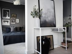 Charcoal and indigo in an elegant Swedish home - bedroom and 'cloud' poster. Historiska Home.