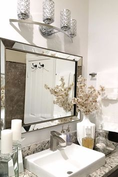 A mirror naturally draws one's attention and adding a fancy one will keep it the focus of a space. If you're out of ideas on what you want the focal point to be make it the most obvious.