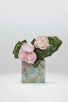 Pink peonies and coconut levaes on marble laquer vase Armani/Fiori