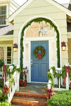 Spruce up the outside of your home with fresh garland wrapped around stairway banisters and archways. Classic outdoor holiday decor!