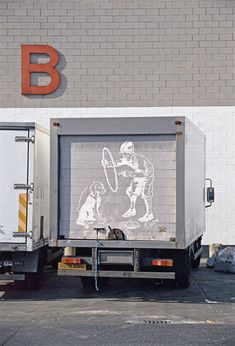 British artist, Ben Long's Dust Drawings. He uses his fingers to create these drawings in the dust.