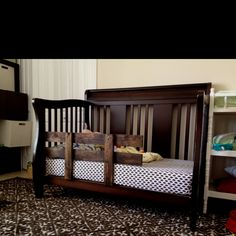 Toddler bed rail made from palette ... Sanded and stained has L brackets to attach pieces that slide under the mattress... new costs around $70 this one cost about $4