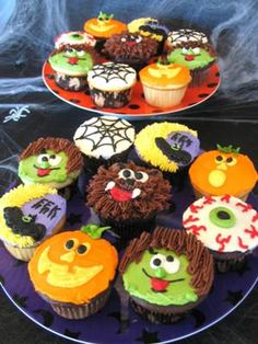 Halloween Cupcakes:  I got the idea for these fun guys out of some different Wilton Yearbooks with Halloween cakes. I used different colored icings to frost them smooth, as