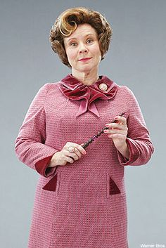 Professor Umbridge, the main antagonist in Harry Potter and the Order of the Phoenix. She worked for the Ministry of Magic and the Minister himself, Cornelius Fudge, who appointed her as a teacher at the Hogwarts School of Witchcraft and Wizardry, in spite of her complete lack of teaching skills, to keep the school and Harry under control. She later reappears as a judge under Voldemort's supremacist reign in Harry Potter and the Deathly Hallows.