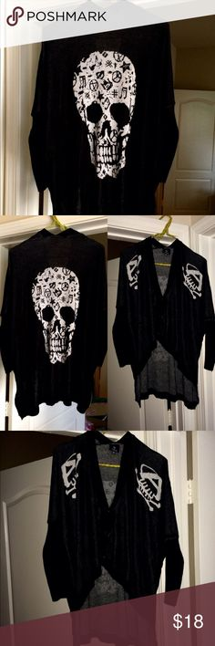 Hi-Low Skull  Cardigan Sweater Awesome black skull sweater! Has 3 buttons in the front. Adorable with a tank and skinny jeans! Size is a small/medium. Sweaters Cardigans