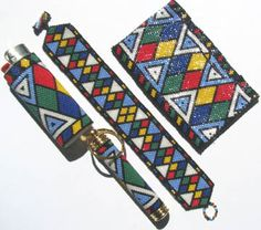 This is an odd and even count peyote or brick stitch set inspired by Zulu beadwork designs. The set consists of a bracelet, a business card holder, a Bic lighter cover and a secret compartment keychain cover.