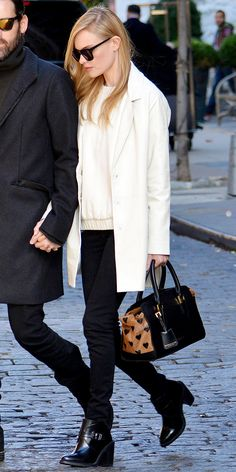 Kate Bosworth takes a stylish stroll in NYC wearing Karen Walker sunglasses, Topshop coat and sweater with a Burberry Prorsum heart print calfskin bag.