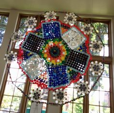 The Eco-Mandala was constructed during Earth Week out of non-recyclable lids.  At the University of Puget Sound (Collins Library)