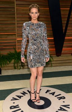 Jennifer Lawrence changed out of her red Dior Oscars gown and into this Tom Ford party dress. ..rh