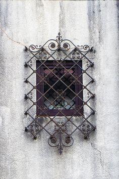 Barred oriental styled window