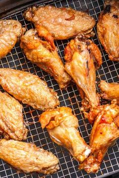 Easy Air Fryer Chicken Wings are so crispy and delicious without using any extra oil! Cooking Chicken Wings in an Air Fryer instead of deep-frying or baking them in the oven makes them healthier, simpler and clean up easier. They're ready in only 30 minutes and you only need 2 ingredients! Toss them with buffalo sauce or your favorite BBQ sauce for an easy appetizer that's perfect for your game day party! #AirFryerRecipes #appetizer #wings #buffalowings #hotwings #gameday