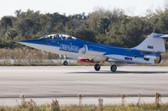A Lockheed F-104 Starfighter jet lands at Kennedy Space Center in Cape Canaveral on Tuesday after completing the maiden flight of a device known as Dust at Altitude Recovery Technology, or DART, which is being used to sample African dust in Florida's atmosphere for potential pathogens of humans, plants and animals. The DART is the red, cylindrical device shown attached to the jet. UF/IFAS photo by Tyler L. Jones.
