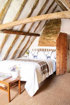 A classic thatched cottage from the outside, the interior of Lesley and Kevin White's Suffolk home is an eclectic mix of English country and Balearic influences Home, Loft Conversion Cost, House Roof, Bedroom Design, Attic Rooms, Cottage Interiors, Thatched Cottage, Cottage Bedroom, Rustic House