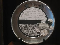 Picture Plate Display I made for a friends wedding gift using a silver charger plate and layering various embellishments
