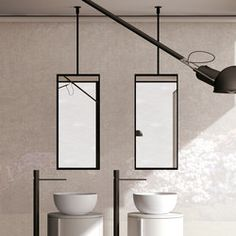 M Is A Suspended Mirror That Uses The Ceiling As Its Only Fixing - Ceiling mounted bathroom mirror