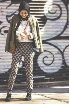 Shop this look on Lookastic:  https://lookastic.com/women/looks/bomber-jacket-button-down-blouse-pajama-pants-boots-crossbody-bag-scarf/2435  — Black Scarf  — Dark Green Bomber Jacket  — White Button Down Blouse  — Black and White Geometric Pajama Pants  — Black Leather Boots  — Tobacco Leather Crossbody Bag
