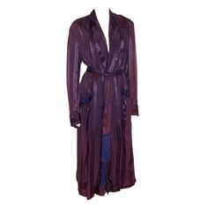 Men's Art Deco, silk/rayon/satin striped smoking/lounging robe in a deep aubergine color. The robe has a breast pocket and a pocket at each hip. It has a belt with long fringe for closure and is fully lined.