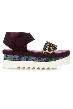 """The Fashion ShoeThe 2014 Trend: the """"ugly"""" shoe (Marni, Céline, Marc Jacobs) The 2015 Counterpart: the elevated """"ugly"""" shoe (Robert Clergerie, Stella McCartney, Marni) Good news, ugly-shoe-enthusiasts. Those clunksters you kicked it in through all of last year are still in the spotlight — with a little extra oomph, thanks to flatform details. We're particularly partial to this multi-patterned Stella McCartney pair. Just imagine donning these beauties with glittery socks this winter."""