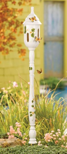 Collections Etc.: Spindle butterfly house. LOVE this! They're out of stock, but I bet I could make something similar.