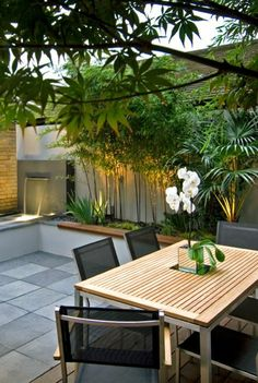 amenagement terrasse exterieur et sol en carrelage d'extérieur, meubles de jardin