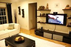 Do basment TV wall like this with shelves around and cabinet underneath