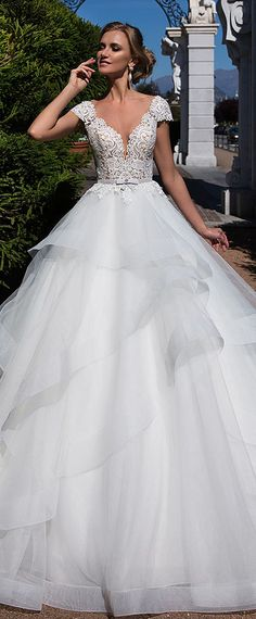 Wonderful Tulle Sheer Bateau Neckline A-line Wedding Dress With Lace Appliques & Belt & Ruffles