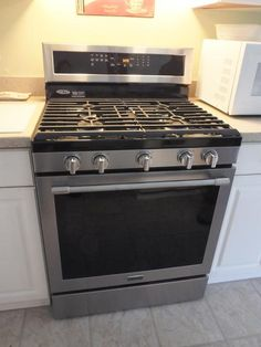 Maytag 30 in. 5.8 cu. ft. Gas Range with True Convection in Fingerprint Resistant Stainless Steel MGR8800FZ at The Home Depot - Mobile