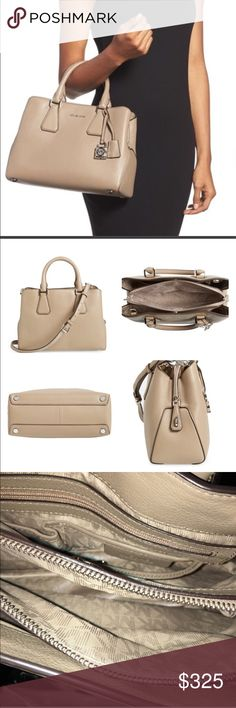 """NWOT HARD TO FIND MK CAMILLE SATCHEL MK Satchel Camille is hard to find! I've looked every where to find a reasonable price and couldn't find one in this color """"out of stock"""" I received this as a gift and never used it, it's an amazing bag! It is lined with middle compartment zipped, 1 zip and multiple slip pockets, magnetic snap closure, silver hardware to finish a sophisticated look! MK Lock and Key! Again, Sophisticated! It has double rolled handles, drop is 4.5 the adjustable Crossbody…"""