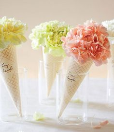 Are They Ice Cream or Flowers? Pretty Table Centerpieces for an Ice Cream Party    This is a great idea for centerpieces... Might even be able to use this for my Halloween carnival themed wedding reception.