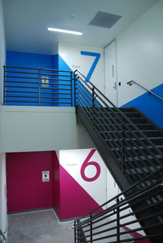 Stairwell graphics in the Box Redwood City office. Floors were assigned colors from the Box brand for wayfinding purposes. Wayfinding Signage, Signage Design, Piscina Spa, Hospital Signage, Office Graphics, Corridor Design, City Office, Environmental Graphic Design, Sky Design