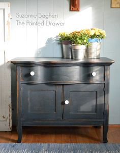 The General Finishes Chalk Style Paint is fantastic to work with and today I'm sharing the Midnight Blue Farmhouse Cabinet before and after!
